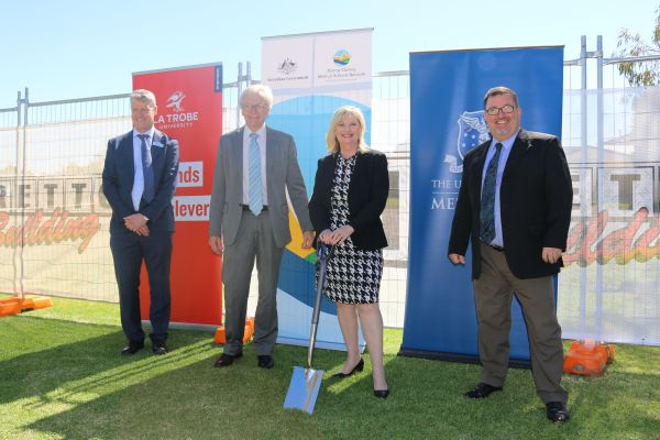 Important community members and University of Melbourne staff turning the sod on construction.